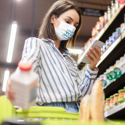 Face Mask Mockup of a Woman Checking Her Phone at the Supermarket 46029-r-el2