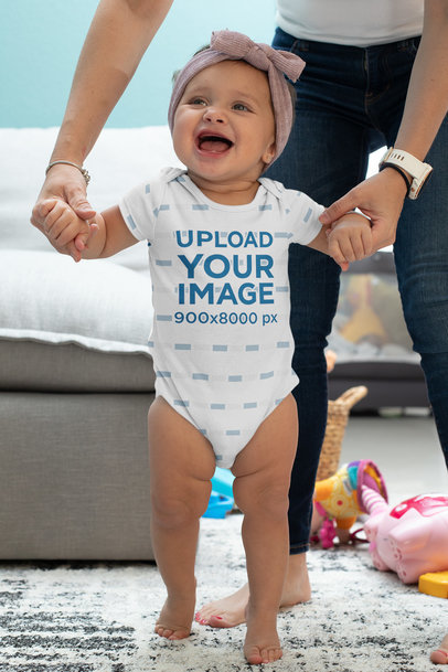Onesie Mockup Featuring a Happy Baby Girl Learning to Walk m926