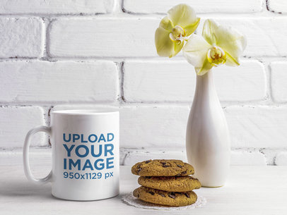 11 oz Coffee Mug Mockup Featuring a Vase With Orchids and Some Cookies 45827-r-el2
