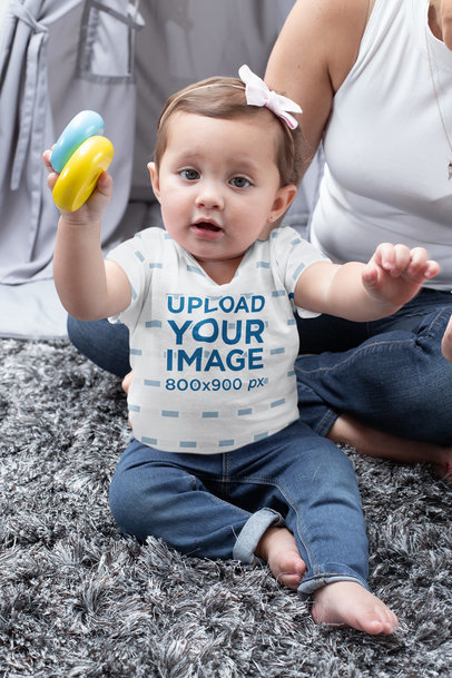 T-Shirt Mockup Featuring a Baby Girl Playing at Home m936