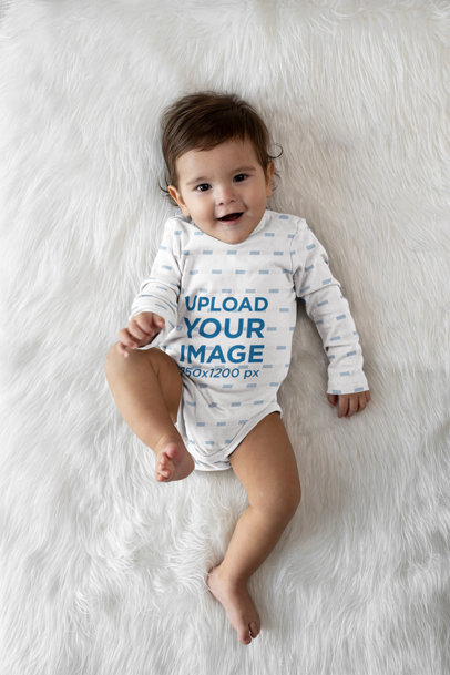 Onesie Mockup Featuring a Baby Laid Down over a Furry Surface m979