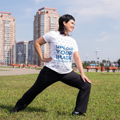 T-Shirt Mockup of a Middle-Aged Woman Stretching at a City Park 46274-r-el2