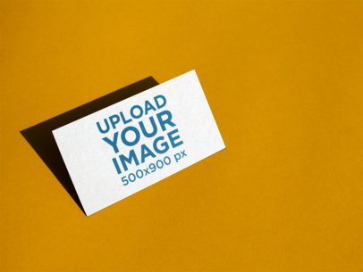 Business Card Mockup Standing Angled on a Yellow Surface a14989