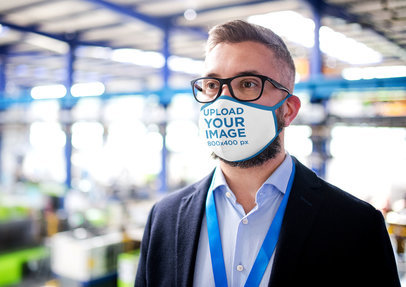 Sublimated Face Mask Mockup Featuring a Bearded Man With Glasses at Work 45995-r-el2