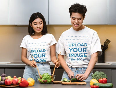 T-Shirt Mockup of a Young Couple Preparing a Salad in a Kitchen 46506-r-el2