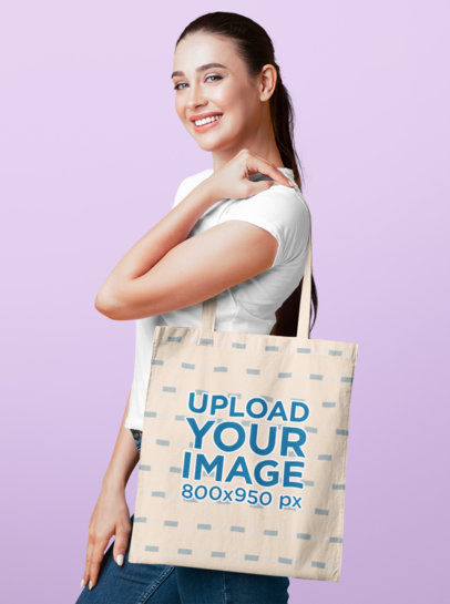 Tote Bag Mockup Featuring a Woman with Long Hair at a Studio 46104-r-el2
