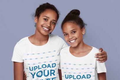 T-Shirt Mockup of Two Sisters Hugging in a Studio 46099-r-el2