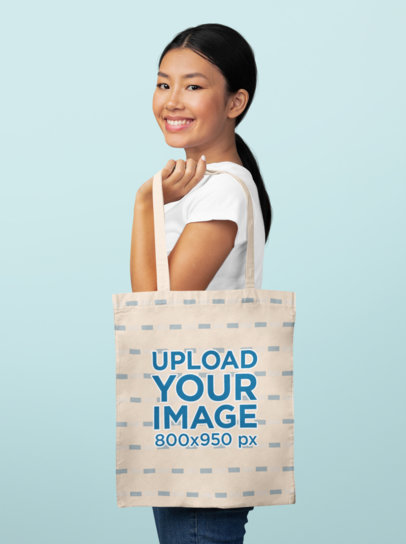 Mockup of a Smiling Woman Holding a Sublimated Tote Bag 46105-r-el2
