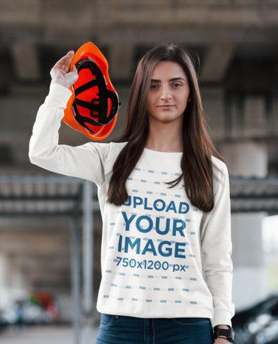 Sweatshirt Mockup of a Young Woman Holding a Construction Helmet 46540-r-el2