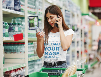 T-Shirt Mockup of a Woman Holding a Bottle of Water at the Supermarket 46431-r-el2