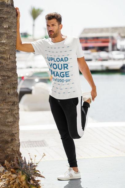 T-Shirt Mockup of a Man Stretching Before a Run 46603-r-el2