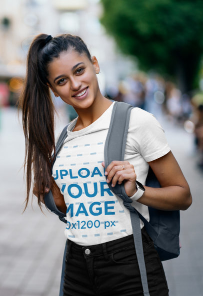 Mockup of a Woman Wearing a T-Shirt and a High-Ponytail While Going to School 46483-r-el2