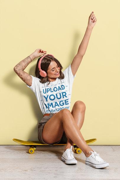 T-Shirt Mockup of a Tattooed Woman Enjoying Her Music 46050-r-el2