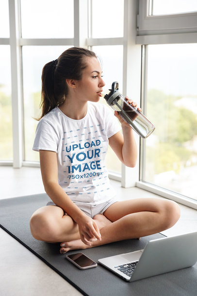 T-Shirt Mockup of a Woman Taking an Online Yoga Class 46614-r-el2
