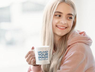 Mockup of a Happy Young Woman Holding an 11 oz Mug 46880-r-el2