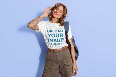 Crew-Neck T-Shirt Mockup Featuring a Tattooed Woman Listening to Music 46313-r-el2