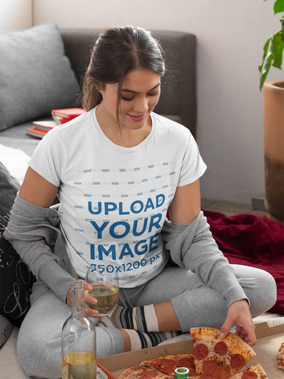 T-Shirt Mockup of a Woman Eating Pizza in Her Living Roomm 1096