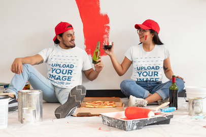 T-Shirt Mockup of a Couple Celebrating While Painting a Room m1069