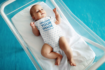 Onesie Mockup Featuring a Baby Boy on a Small Crib 45748-r-el2