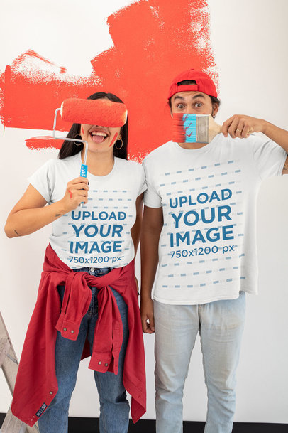 T-Shirt Mockup Featuring a Joyful Couple Painting a Wall  m1074