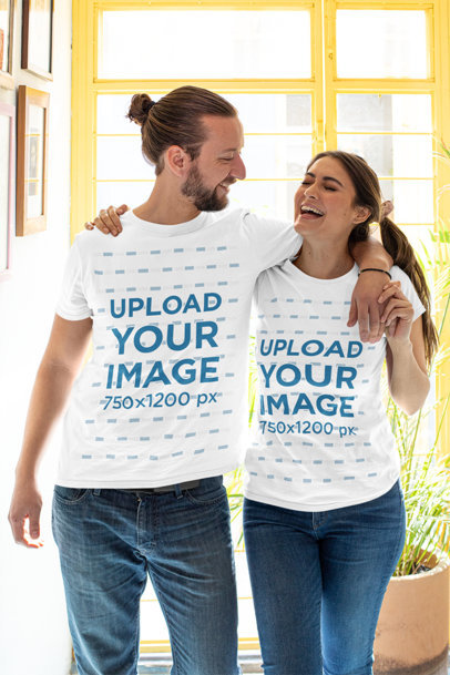 T-Shirt Mockup of a Happy Couple Posing at Home m1109