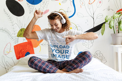 T-Shirt Mockup of a Happy Man Listening to Some Music in His Pajamas 46068-r-el2
