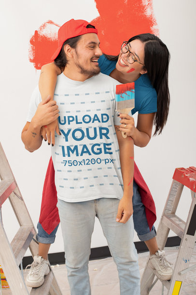 T-Shirt Mockup Featuring a Man Having Fun Painting with His Girlfriend m1073