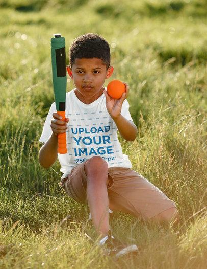 T-Shirt Mockup of a Serious Kid Holding a Toy Baseball Bat 43845-r-el2