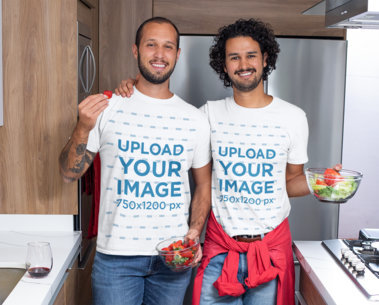 T-Shirt Mockup of Two Men Having an Indoor Date M1062