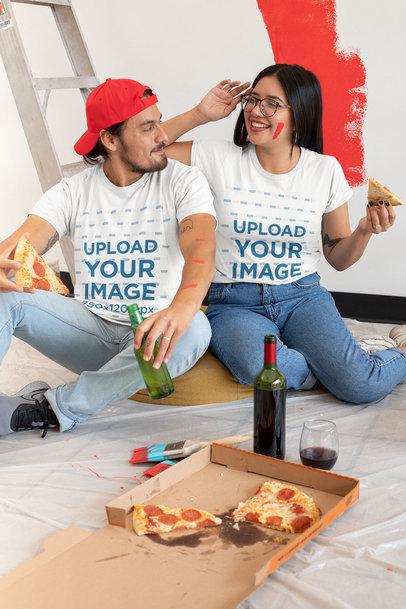 T-Shirt Mockup of a Young Couple Eating Pizza m1076