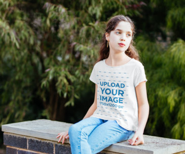 T-Shirt Mockup Featuring a Curly Haired Girl Sitting on a Bench 40903-r-el2