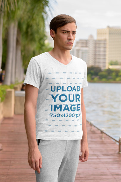 V-Neck T-Shirt Mockup of a Serious Man Standing by a River 44421-r-el2