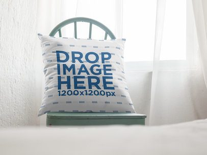 Mockup of a Square Pillow Lying on a Chair Inside a Room a15173
