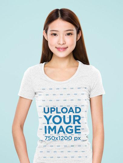 Mockup of a Young Woman Wearing a Heathered T-Shirt at a Studio 46672-r-el2