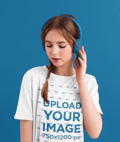 Mockup of a Woman in a Loose T-Shirt Wearing Headphones 46171-r-el2