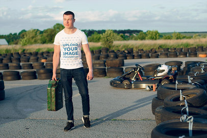 T-Shirt Mockup of a Muscular Man on a Go-Kart Track 43172-r-el2