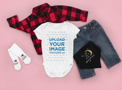 Onesie Mockup Featuring a Baby Boy's Outfit and a Customizable Background m1152