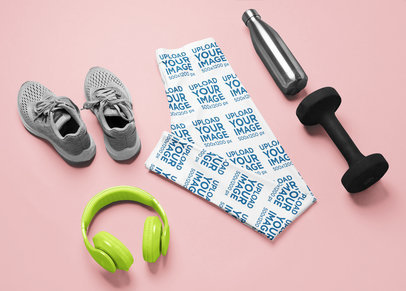 Mockup of a Pair of Leggings Laid Flat Surrounded by Gym Stuff M1207