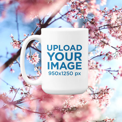 Spring-Themed 15 oz Coffee Mug Mockup Featuring a Floral Background m1415