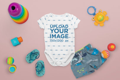 Mockup of a Baby Onesie Surrounded by Toys M1129