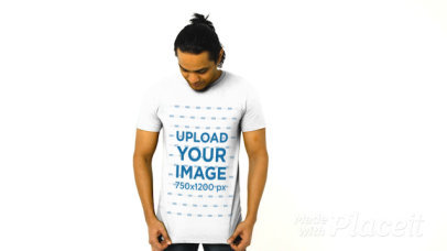 T-Shirt Video of a Man Posing in a Studio with Plain Background 44698a
