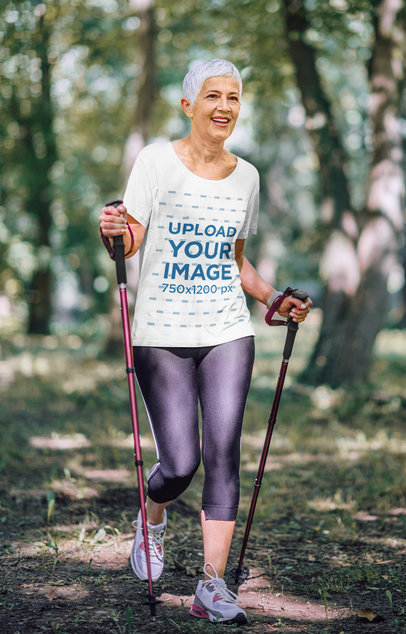 T-Shirt Mockup of a Senior Woman Enjoying a Hike in the Woods 40083-r-el2