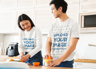 Long Sleeve Tee and T-Shirt Mockup of a Young Couple Making Orange Juice in the Kitchen 42489-r-el2