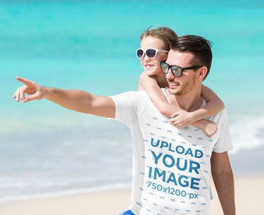 T-Shirt Mockup of a Man at the Beach Carrying His Daughter 40679-r-el2