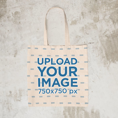Mockup of an Empty Tote Bag on a Surface with a Raggedy Texture m1255