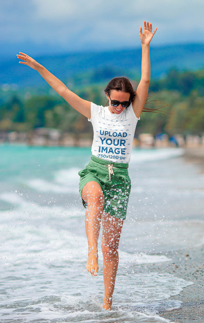 T-Shirt Mockup of a Woman Having Fun at the Beach 44471-r-el2