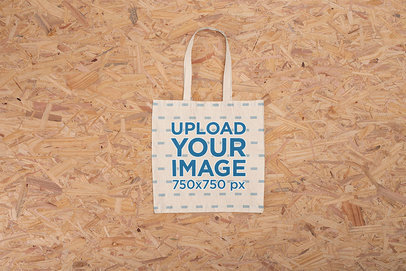 Sublimated Canvas Bag Mockup Featuring a Wooden Background m1229