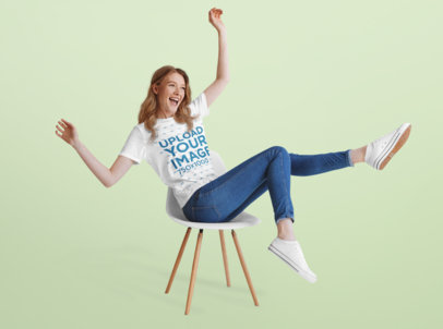 T-Shirt Mockup of a Happy Woman Sitting on a Chair at a Studio 40306-r-el2