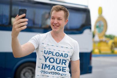 V-Neck Tee Mockup Featuring a Smiling Man Taking a Selfie 42479-r-el2