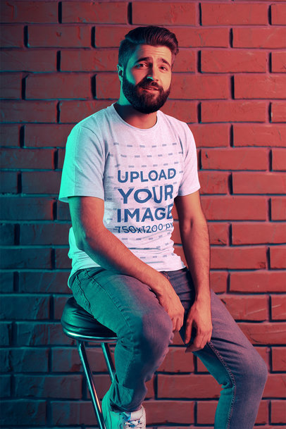 Mockup Featuring a Bearded Man With a T-Shirt Sitting Against a Brick Wall 42669-r-el2